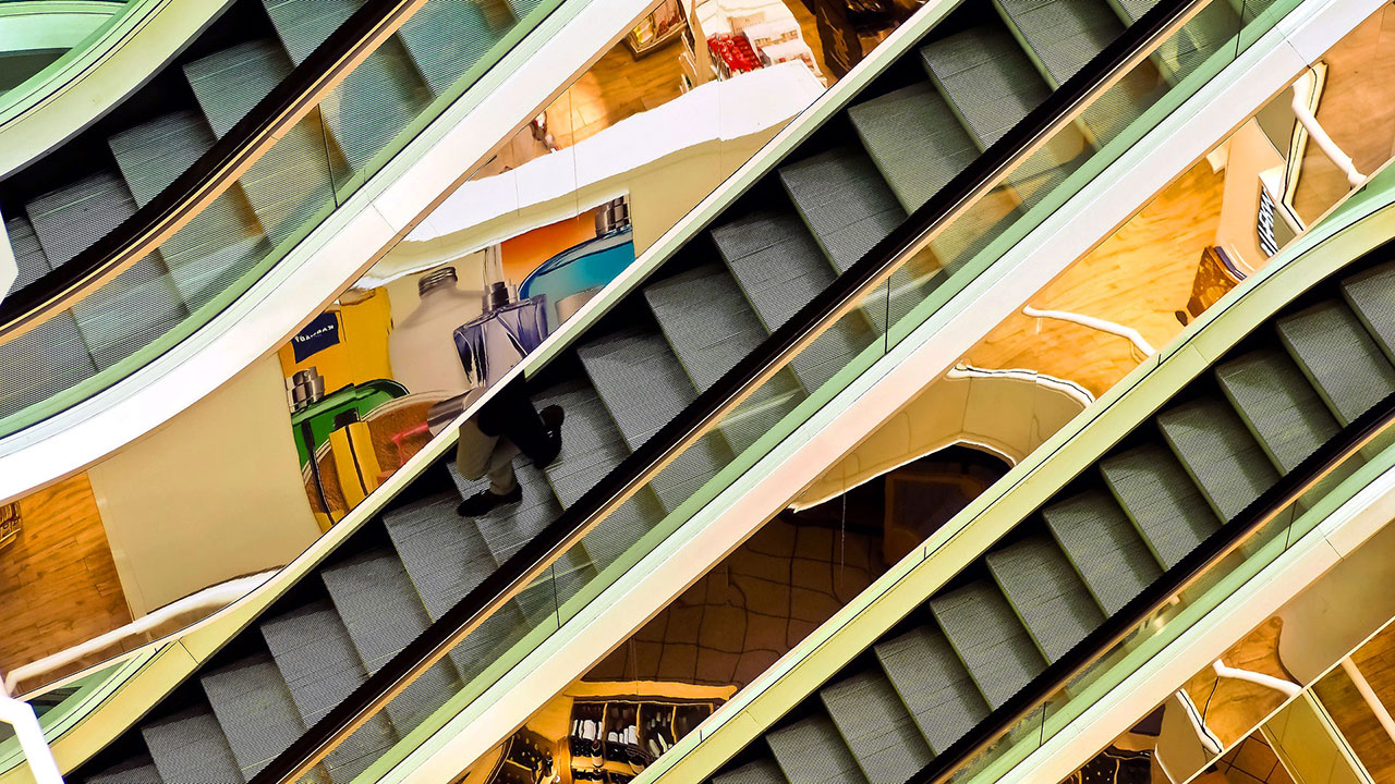 a detail of escalators in a shopping mall