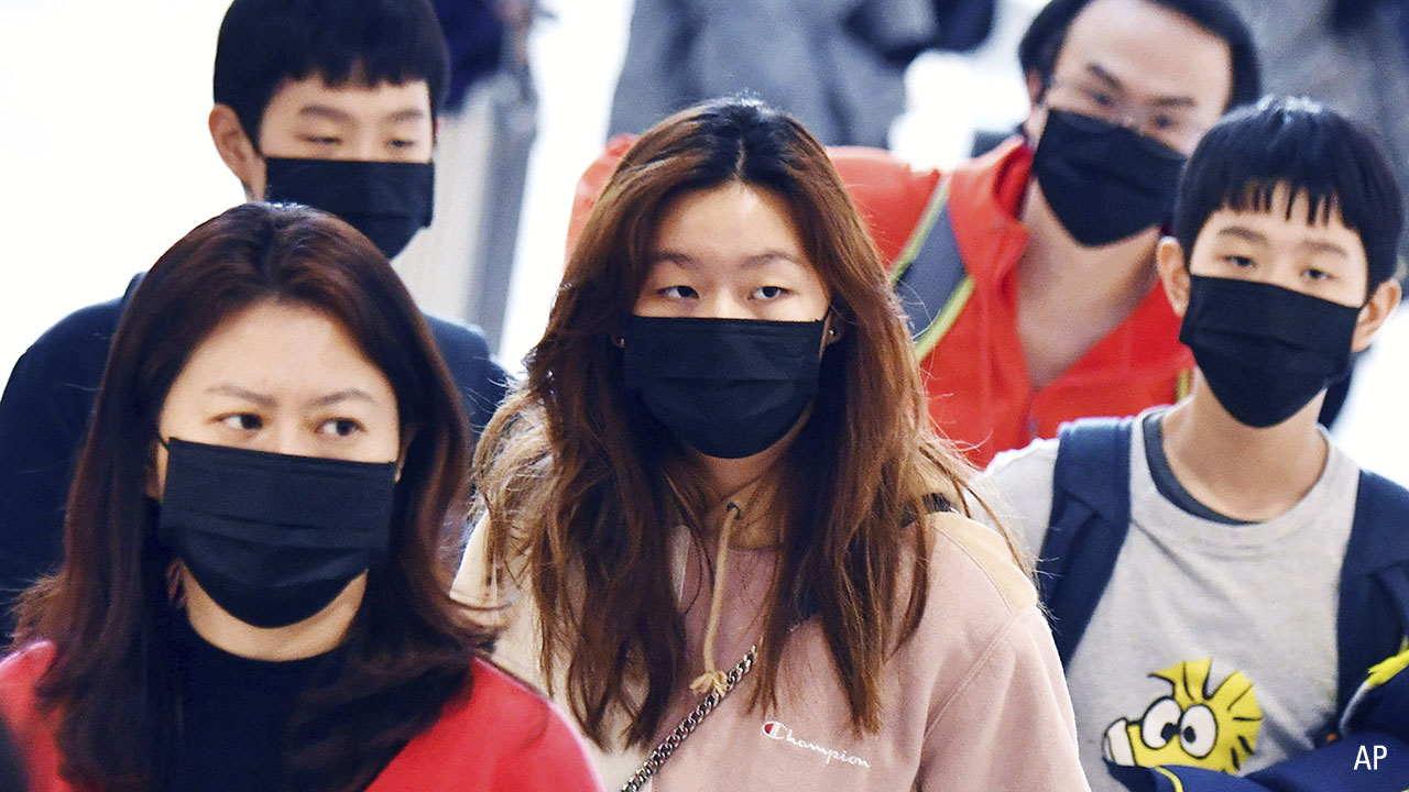 people walking with face masks on