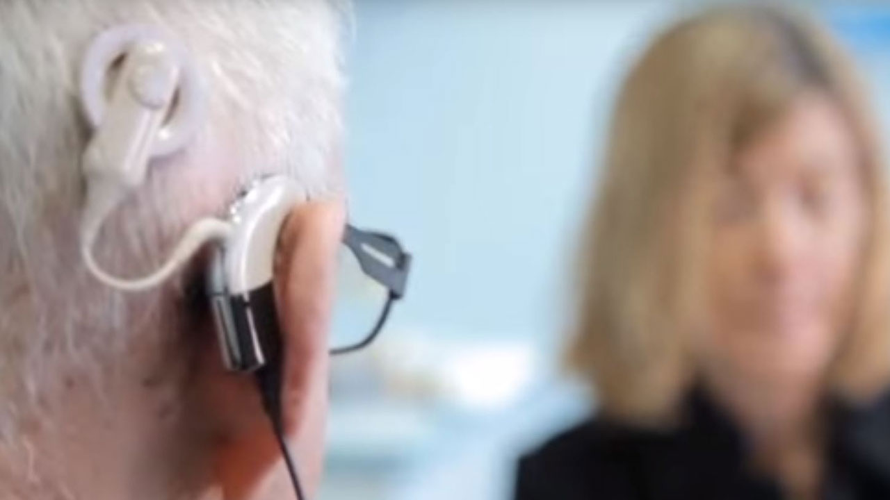 Man wearing cochlear implant