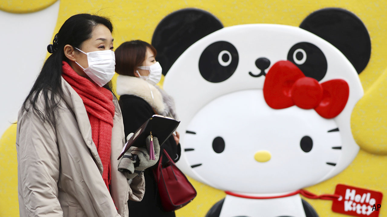 a picture of a woman walking in Japan wearing a face mask