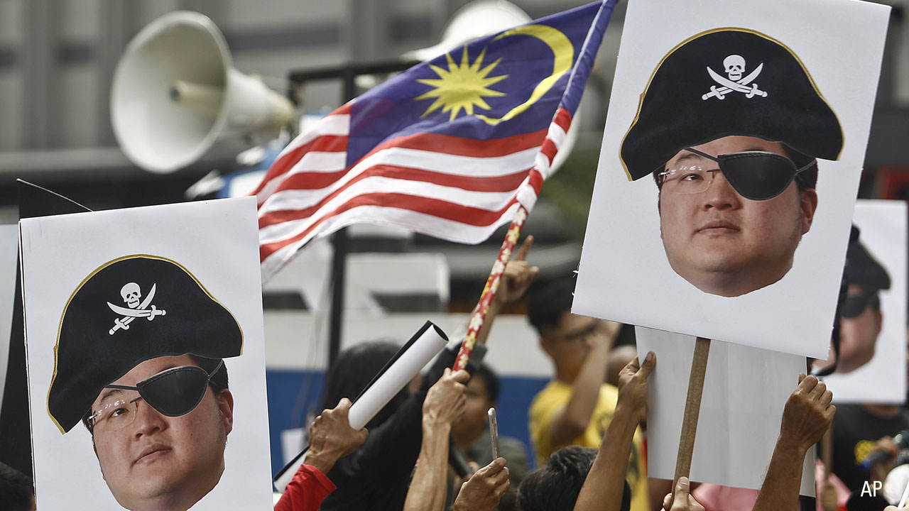 Protesters brandish effigies of fugitive Jho Low