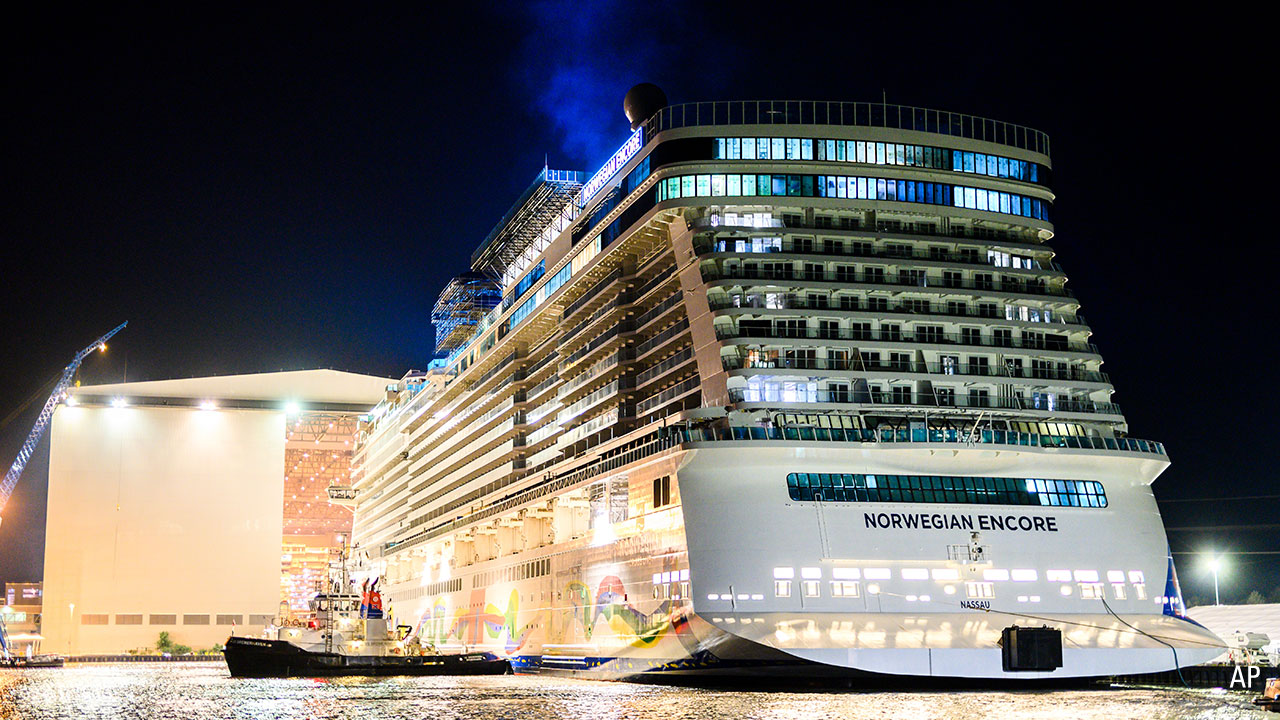 """The cruise ship """"Norwegian Encore"""" leaves the Meyer Werft building dock at night"""