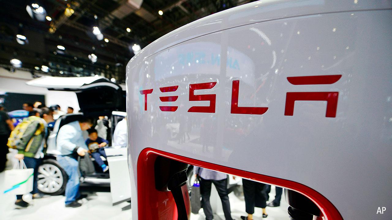 A Tesla charging at a car show