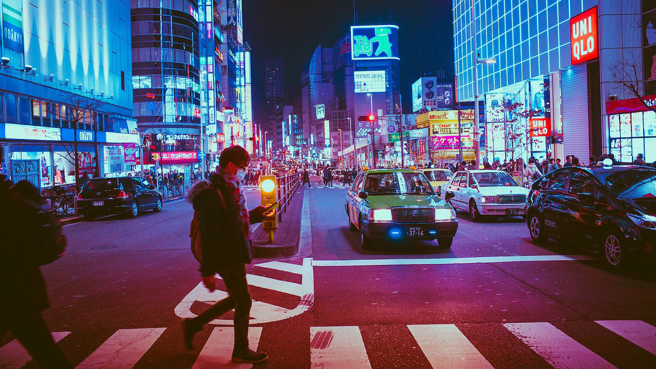 Man at pedestrian crossing in Tokyo street