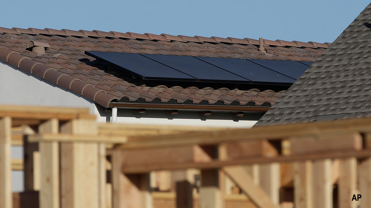 Solar panels are seen on the rooftop on a home in a new housing project in Sacramento, California